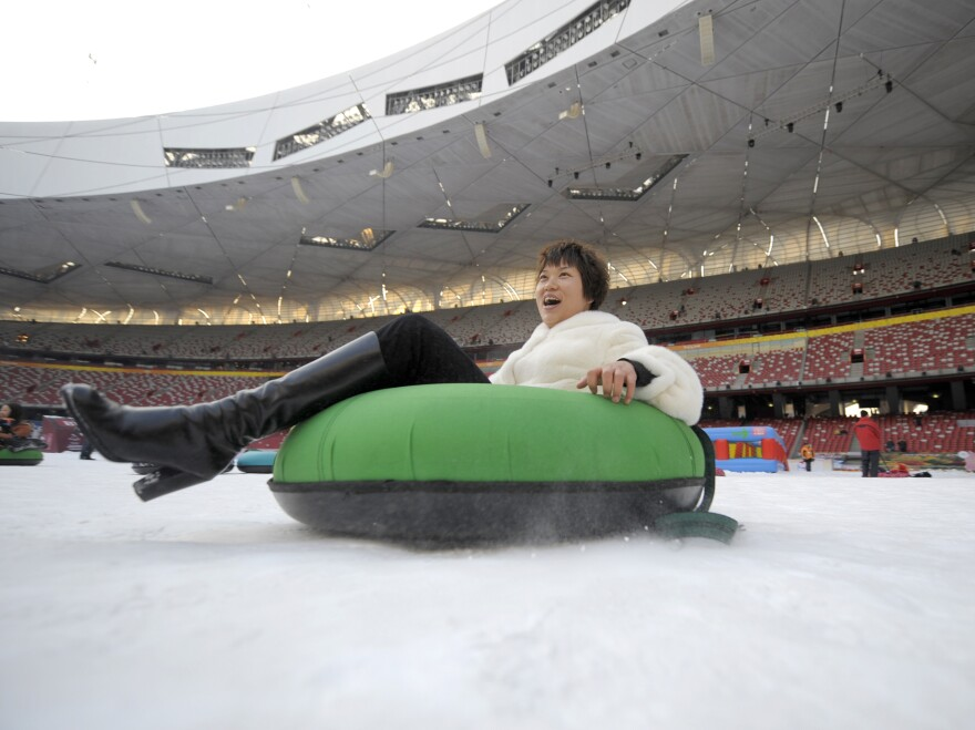 A woman goes snow-tubing in January 2010 inside the Bird's Nest, which was transformed temporarily into a winter theme park.