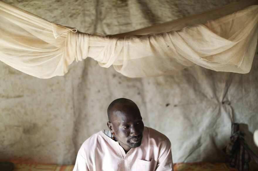 David, a South Sudanese health worker at the MSF facility, sits on his bed in his shelter. He's one of the 124,000 people who've come to the camp to escape the fighting. We were asked by MSF only to use the first names of local employees for security reasons.