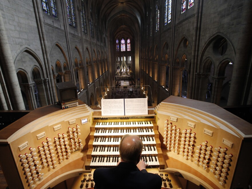 "Organist Philippe Lefebvre plays at Notre Dame in 2013. Sophie Benn, a musicologist at Case Western Reserve University, says the acoustics of the cathedral are ""baked into the DNA of classical music."""