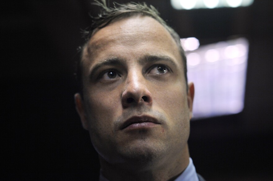 South African Paralympic sprinter Oscar Pistorius stands  in the Magistrate Court in Pretoria on Tuesday.