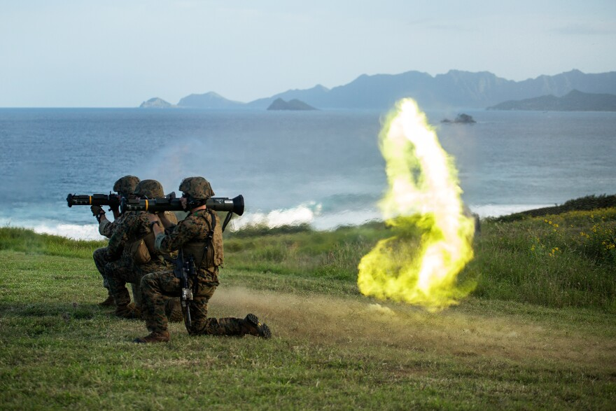 Marines based in Okinawa, Japan, fire an M136 AT-4 rocket launcher as part of a weapons training exercise on the Kaneohe Bay Range Training Facility, in 2014.