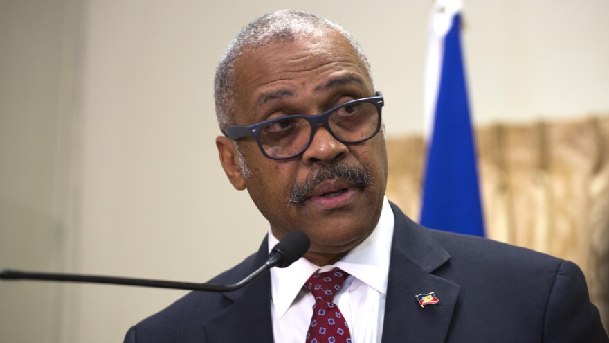 Prime Minister Dr. Jack Guy Lafontant speaks at the national palace in Port-au-Prince, Haiti, in 2017. He resigned following riots over fuel prices.