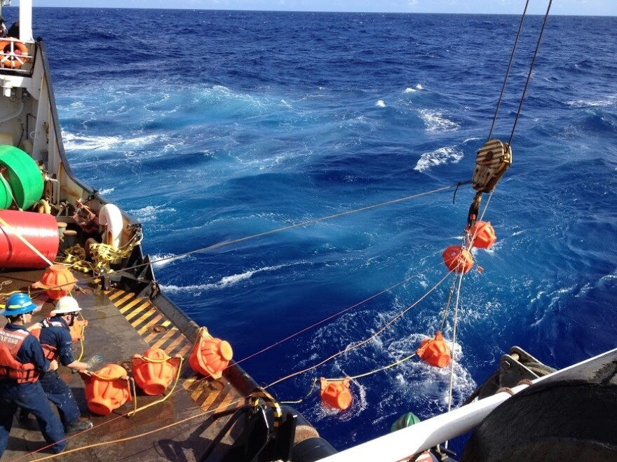 Researchers lowered a specially designed hydrophone mooring from a Coast Guard cutter and down into the Mariana Trench.