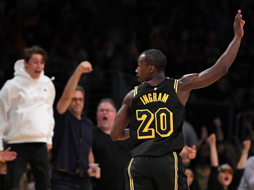 Andre Ingram celebrates after draining a 3-pointer during the second half Tuesday night.