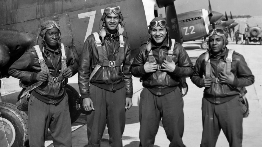 The Pentagon has identified the remains of Lawrence E. Dickson (second left), pictured in 1942 with members of the graduating class at Tuskegee Army Flying School.