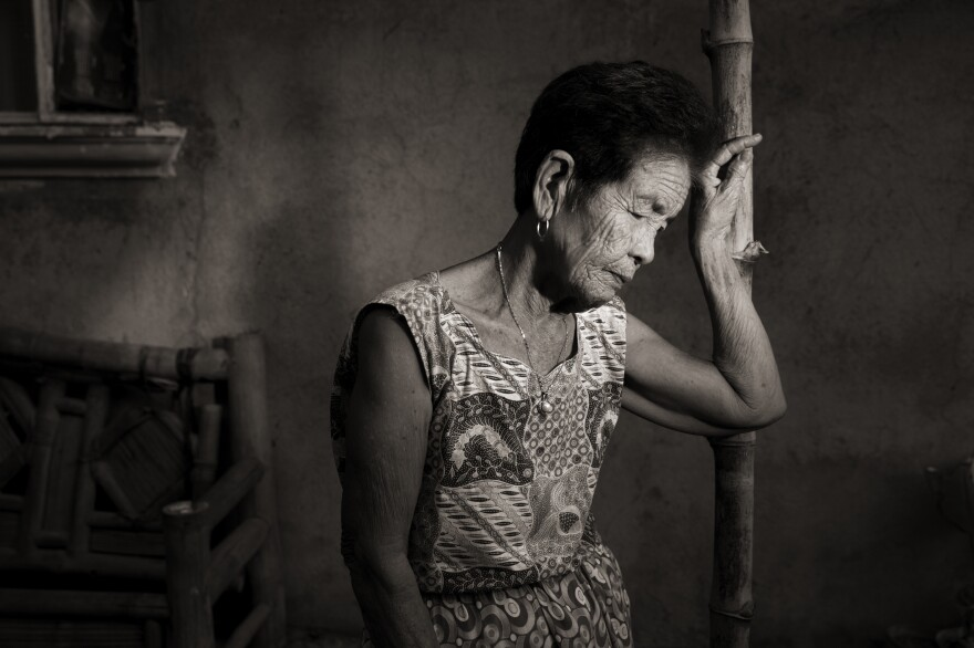 """When we arrived to the Red House, I was pushed so hard that I was knocked unconscious, so I don't recall what happened to me ... but even today, I feel the pain in my body,"" said Maria Lalu Quilantang, who was 9 years old when her village of Mapaniqui was attacked by the Japanese during World War II."