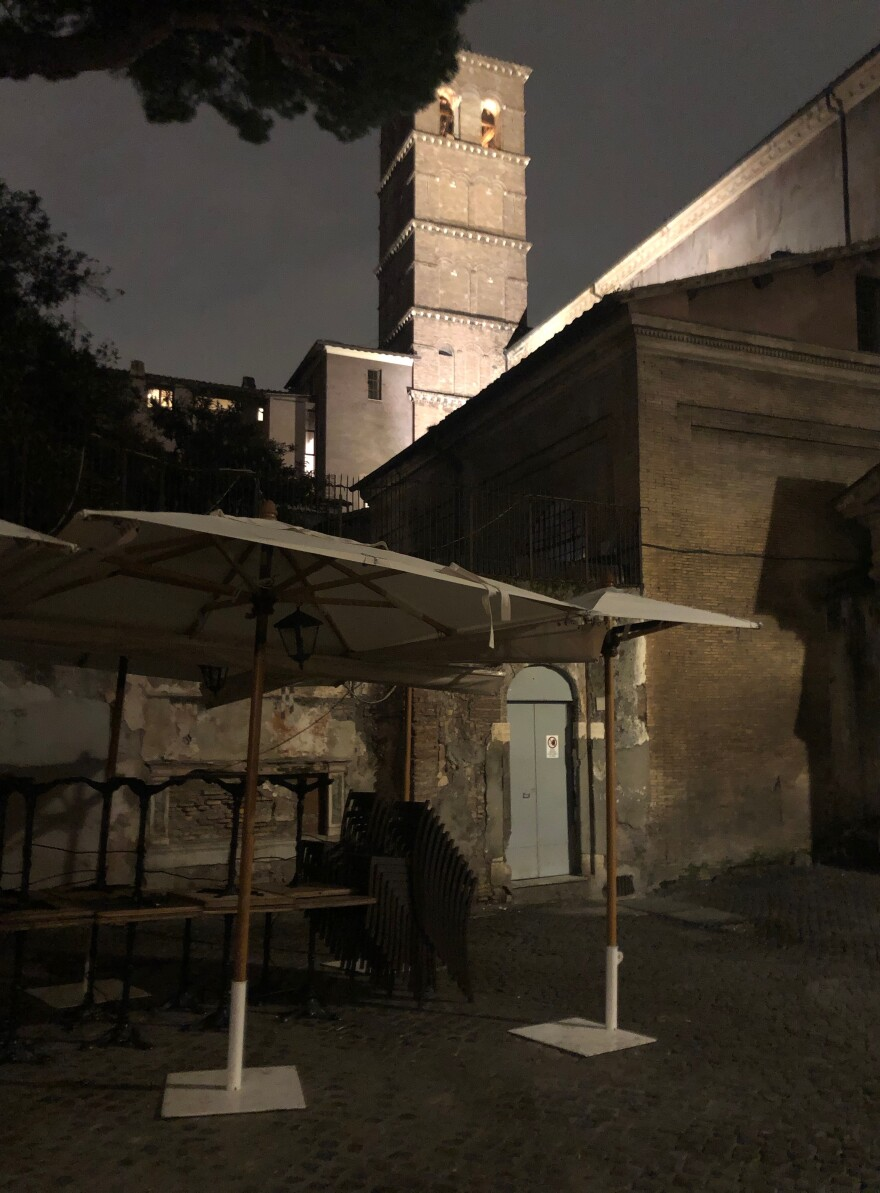 With Roman Catholic Mass banned, the bells of the Basilica di Santa Maria in Trastevere chimed for 10 minutes Saturday at 8 p.m., in a sign of solidarity and prayer for all suffering from the coronavirus.