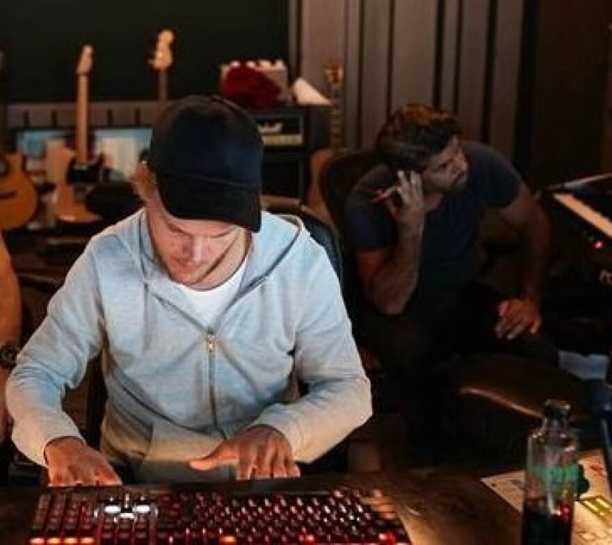 Swedish DJ Avicii, in the studio with producer Carl Falk at right.