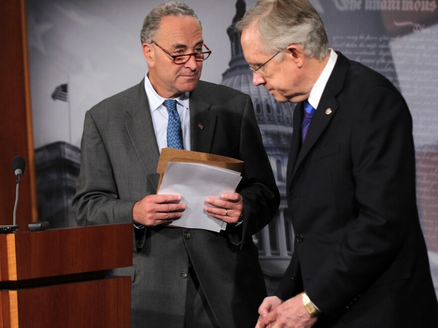 <p>Left to right: Sen. Charles Schumer (D-N.Y.) and Senate Majority Leader Harry Reid (D-Nev.) at a news conference on Capitol Hill today.</p>