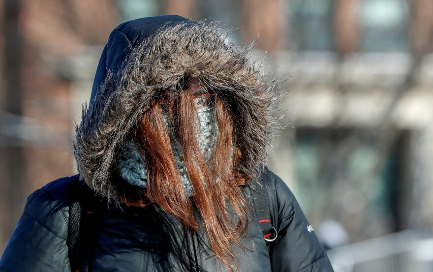 On Tuesday, a student dressed for subzero temperatures while walking to class at the University of Minnesota in Minneapolis. Classes in universities across the Midwest were closed because of the cold.