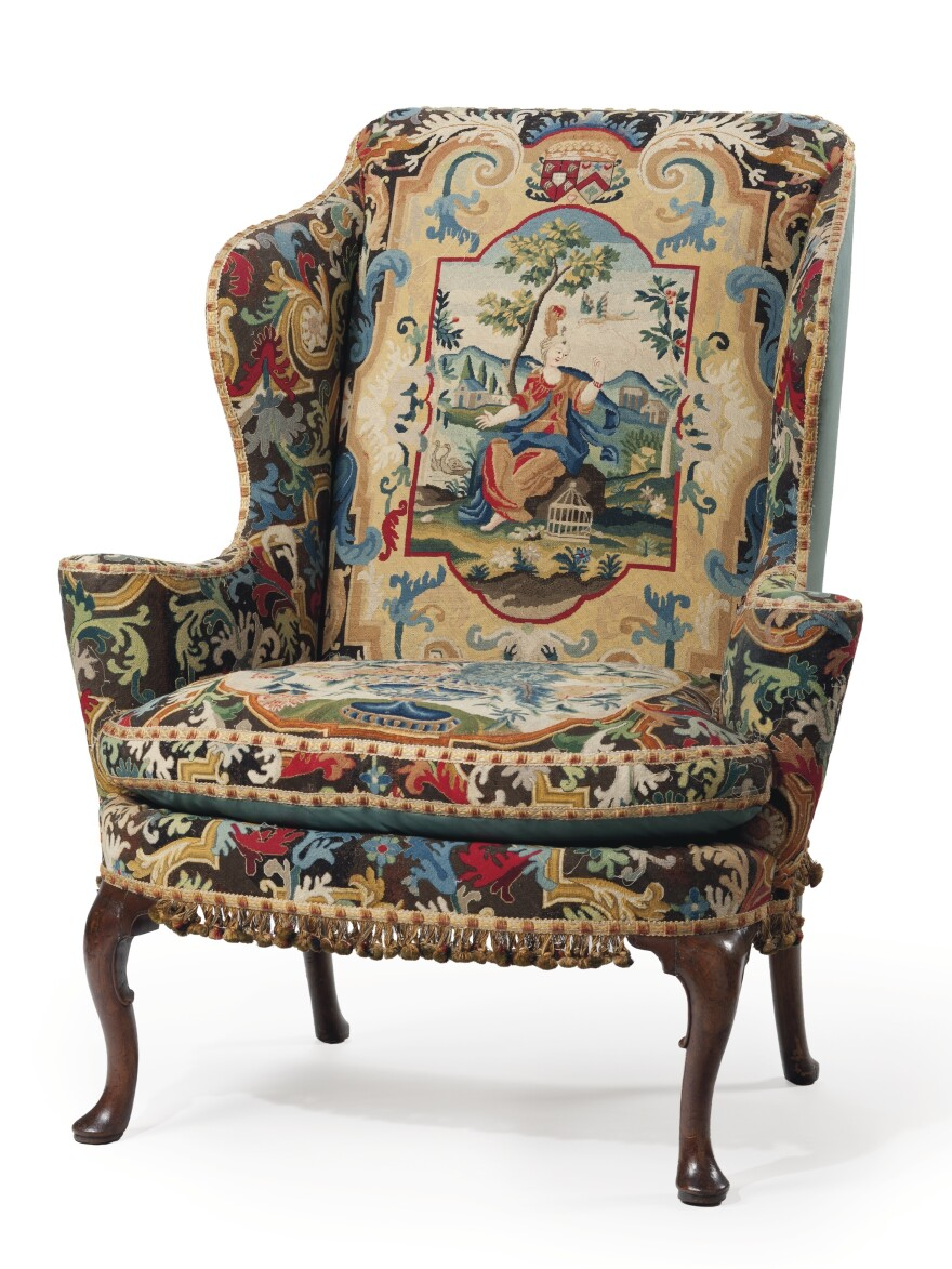 The George I Walnut and Beech Wing Armchair, circa 1725, covered in 18th century gros point and petit point needlework, is one of Huguette Clark's many belongings headed to auction.