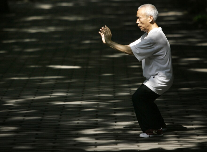 A man performs tai chi for his morning exercise in Beijing, China.