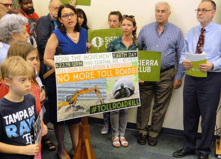 St. Petersburg City Council member Darden Rice, at podium, and Sierra Club Florida Chapter Director Frank Jackalone, right, rally against the toll road bill.
