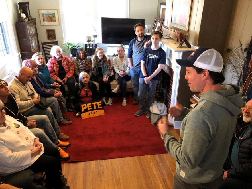 Clarke Tucker (right) speaks to supporters of former South Bend, Ind. Mayor Pete Buttigieg at a home in Little Rock.