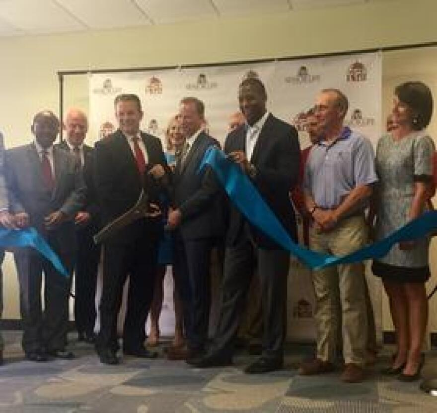Tallahassee and Leon County officials join with principals of Senior Life Insurance Company at the Summit East ribbon cutting.