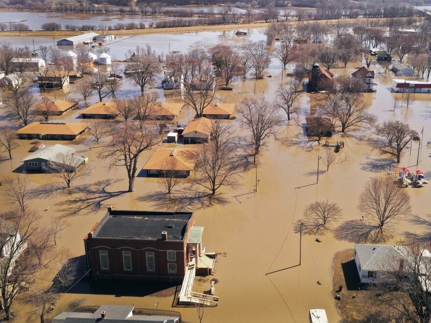 Homes and businesses are surrounded by floodwater Wednesday in Hamburg, Iowa.