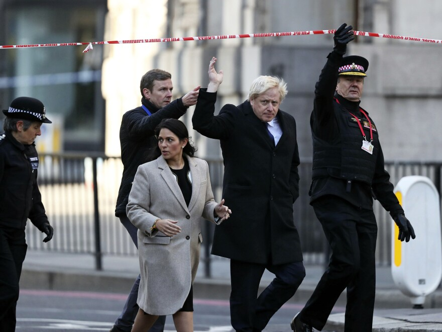 British Prime Minister Boris Johnson (second from right), Home Secretary Priti Patel (front center) and Metropolitan Police Commissioner Cressida Dick (far left) attend the scene in central London on Saturday.