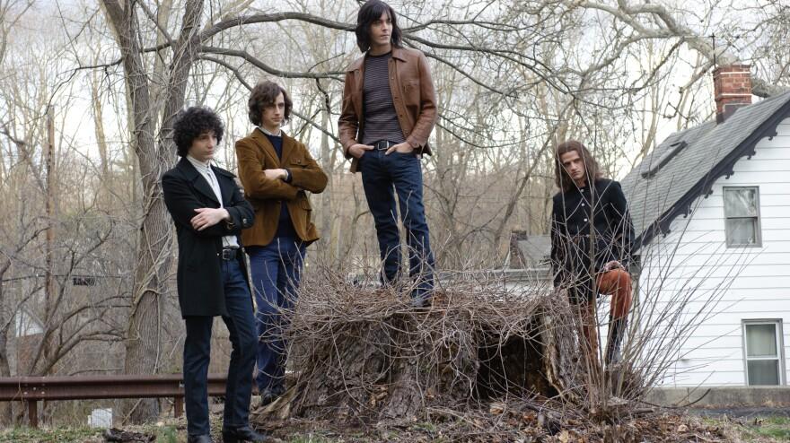 John Magaro (left), Brahm Vaccarella, Jack Huston and Will Brill play aspiring rock stars in <em>Not Fade Away</em>.
