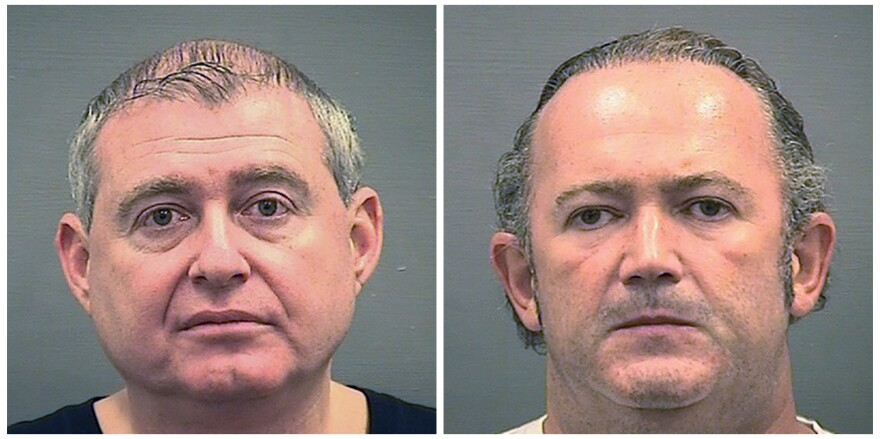 Lev Parnas (left) and Igor Fruman are shown after their arrest on Oct. 9 at Dulles International Airport, outside Washington, D.C.