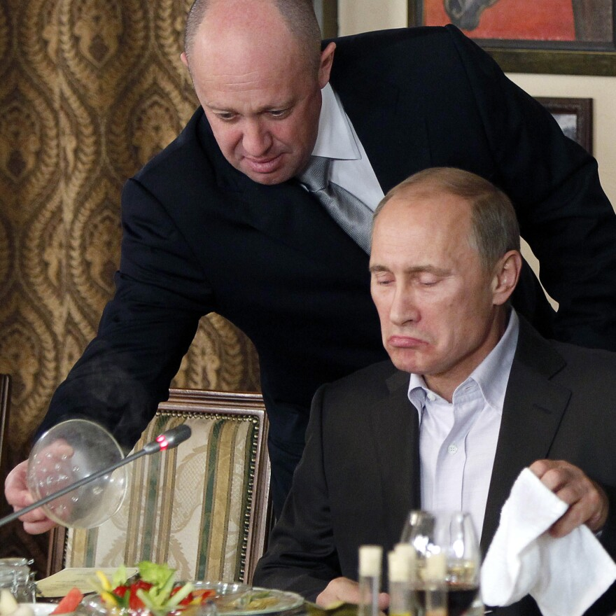 """An attorney defending Yevgeny Prigozhin, left, dubbed the """"cook"""" to Russian Prime Minister Vladimir Putin, said he intended to fight vigorously against charges brought by the special counsel's office."""