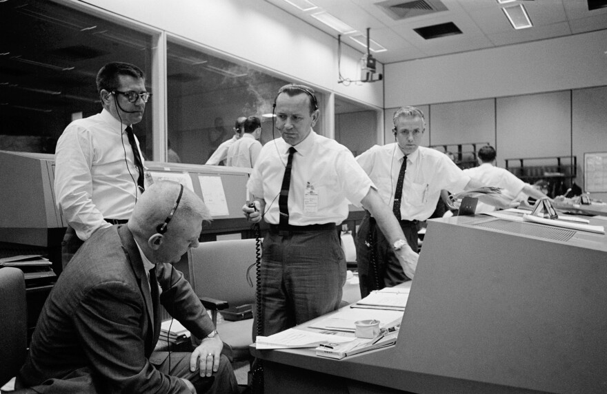 Chris Kraft (center) discussing the scrubbing of the planned Gemini 6 spaceflight in 1965.