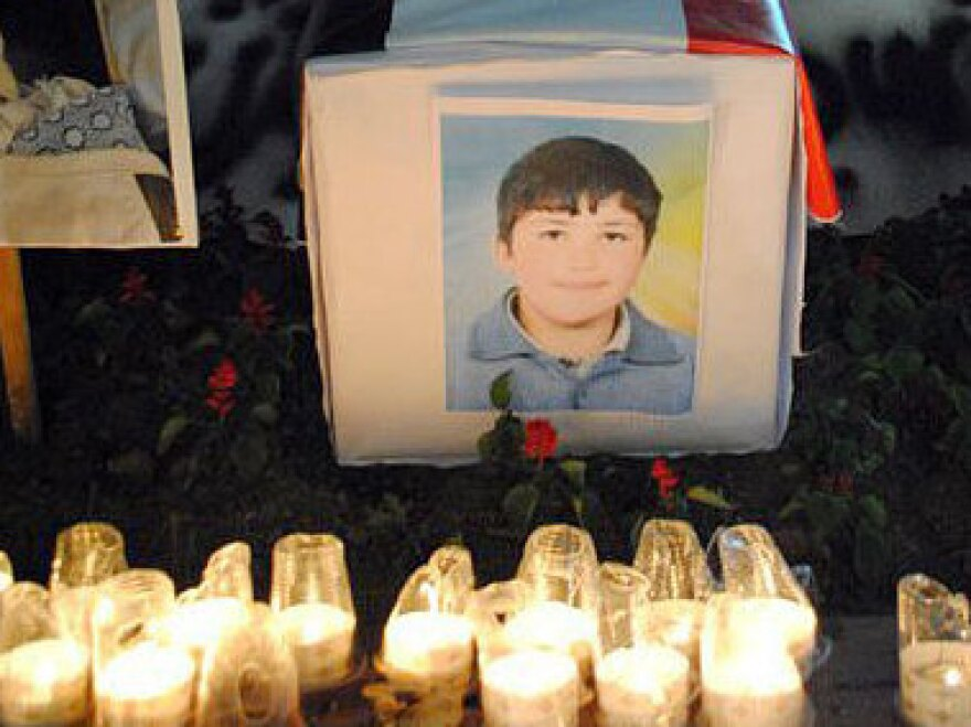 An image of 13-year-old Hamza al-Khateeb is surrounded by candles in this photo from a Facebook page in his memory.