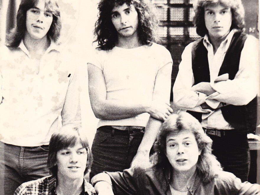 <p>With shaggy hair and skinny jeans, Jon Huntsman (upper right) strikes a pose with his band, Wizard. </p>
