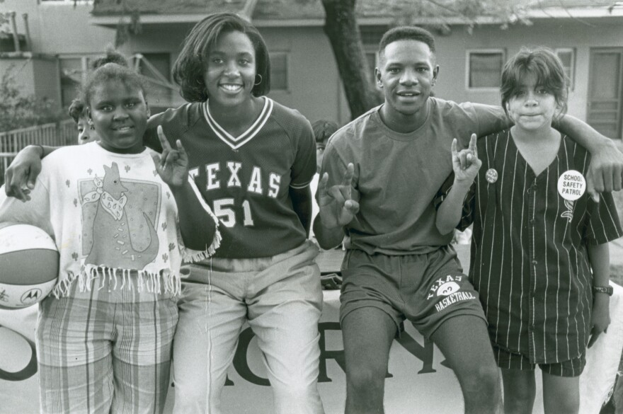 Photographs from The Villager Newspaper, like this 1992 image of UT Austin basketball players Joanna Benton and Tony Watson with Neighborhood Longhorns Program participants, are on display at the Austin History Center until April 19.